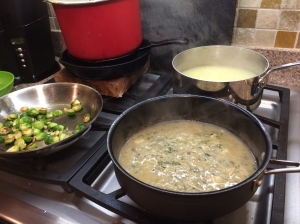 The soup reheats while the mustard and thyme sauce thickens and the brussels sprouts carmelize